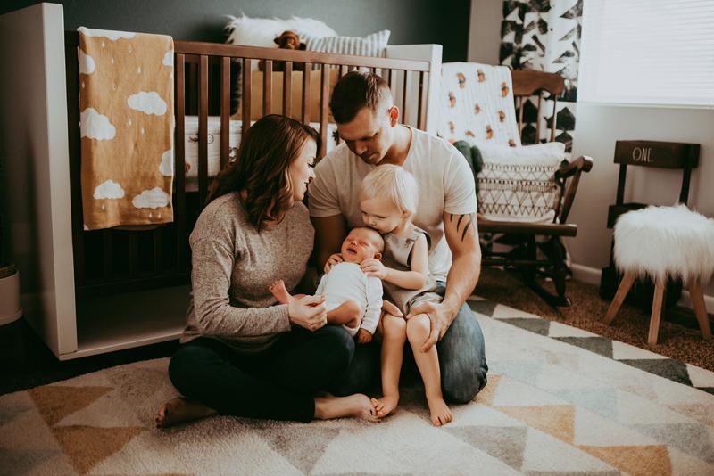 Spokane Family Photographer, family sitting next to crib playing together