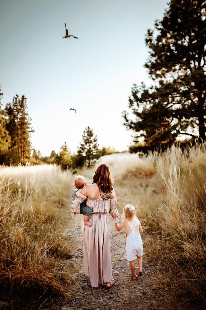 Spokane Family Photographer, mother walking with her children