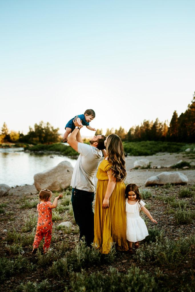 Spokane Family Photographer, family playing next to lake
