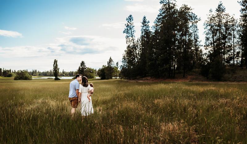 Spokane Family Photographer, family walking through a field